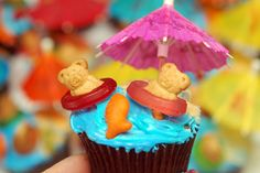 TEDDY BEAR PICNIC Cupcakes - How cute for a pool party or end of the school year.  A few year back at VBS they put the teddy graham on a piece of chewing gum that was folded to look like a lounge chair.  It would make a cute combination.