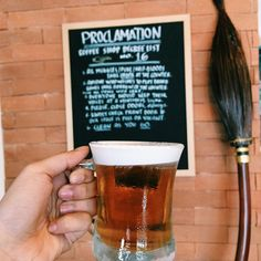 """Pin for Later: Say """"Espresso Patronum"""" (or Butterbeer!) at This Magical Harry Potter Cafe And you can spot Harry's Nimbus 2000 leaning against one of the walls."""