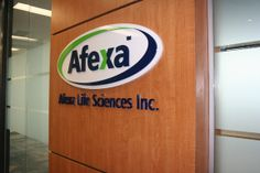 "Afexa - Laser cut 1/2"" Acrylic Oval with 1/2"" PMS painted acrylic wordmark, Tagline is 1/2"" Acrylic flush mounted to wall"