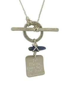 "This elegant sterling silver necklace echoes the immortality of Shakespeare's most famous saying: ""To thine own self be true."" A single blue kyanite gemstone dangles above the inscribed sterling silver plate, which hangs on an 18-inch"