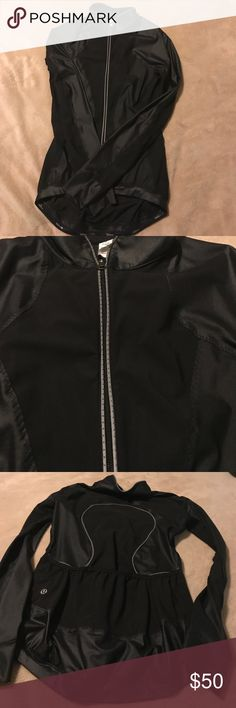Black Lululemon Jacket Lightweight black jacket with detailed sleeves lower in back than front, back has Lululemon logo in silver piping and 3 pockets at waist, entire waist has non slip grip plastic strip excellent condition looks brand new lululemon athletica Jackets & Coats Utility Jackets