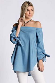 Cute tie long sleeve denim top. Great paired with a skirt or a pair of leggings and/or pants. 65% polyester, 35% cotton. Made in the USA.