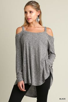 60% cotton, 40% polyester Long sleeves, High Low hem... Dress this up or down. Ribbed, Cold shoulder sweater top. Don't miss this one, it won't last long!!! ...This runs true to size. The back is long