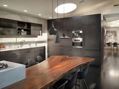 Not really a fan of everything else, a bit too modern for my taste, but I LOVE the dining table!