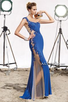 Alyce Claudine 2406 One sleeve slim fit long jersey prom gown featuring delicate beaded lace from the shoulder across the bustline around the open back and on down the sheer nude illusion side onto the flare bottom with slight train. Junior Prom Dresses, Prom Dress 2014, Long Dresses, Wedding Gown Preservation, Sheer Gown, Chiffon, Designer Prom Dresses, Mermaid Evening Dresses, Event Dresses
