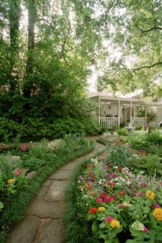 This Large Houston Shade Garden Features A Covered Deck And Patio.