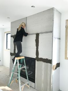 How to DIY a Faux Concrete Fireplace – Modern brick fireplace Stucco Fireplace, Concrete Fireplace, Home Fireplace, Fireplace Remodel, Fireplace Surrounds, Fireplace Design, Diy Faux Fireplace, Fireplace Ideas, Fireplace Makeovers