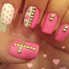 floral and stud nails with cross accent