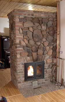 another masonry heater with a pleasing mix of brick and stone