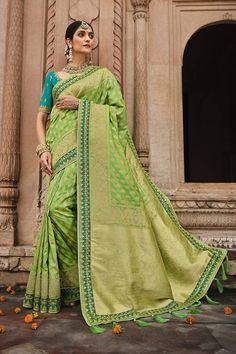 Light green color silk traditional saree with a matching light blue silk blouse. #banarasisarees #banarasisareelookforwedding #banarasisareeblousedesign #banarasisilksaree #banarasisareeblousedesignslatest #sareestyles #saree #sareewedding #sareegown #sareedesignspartywear #indianweddingoutfits #indianfashion #indiandesignerwear #indianbridalfashion #weddingdresses #wedding #bridalblousedesigns Saree Designs Party Wear, Bridal Blouse Designs, Latest Silk Sarees, Silk Sarees Online, Black Saree, Green Saree, Indian Bridal Fashion, Indian Wedding Outfits, Green Silk