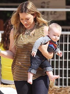 See how Hilary Duff and her little guy Luca made their pumpkin patch visit a stylish affair.