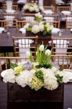 rustic white tulip wedding centerpiece / http://www.himisspuff.com/white-tulip-wedding-ideas-for-spring-weddings/7/