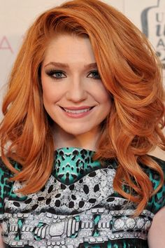 Nicola Roberts we salute you for embracing your fiery red-hair. Vibrant and voluminous.