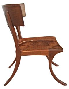 Extremely rare Mahogany Klismos chair by Edward Wormley for Dunbar, 1940s. This original rendering of the Klismos form was designed by Edward Wormley for his own dining room and were made at the Dunbar workrooms. The chairs were never offered as a production item. Freshly refinished and reupholstered with hair on cowhide.