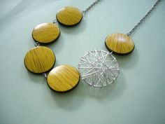 Yellow black necklace with wood effect. $28.00, via Etsy.