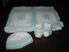 Green and white blanket, hat and booties.For girl or boy. The special and unique gift for that baby shower.