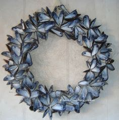 How to make a mussel shell flower wreath, First step: eat 150000 mussels, Would be pretty backed with mirror and used as tray at reception, Ideas que mejoran tu vida, Clams in a fishnet. ^^ CLIK PIN FOR MORE INFO ^^ Easy Seashell Crafts Seashell Wreath, Seashell Art, Seashell Crafts, Sea Crafts, Nature Crafts, Oyster Shells, Sea Shells, Oyster Shell Crafts, Seashell Projects