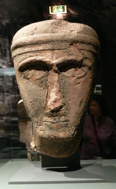 """Nabatean artifact.    Pergamon Museum ( Berlin ). Exhibition """"Roads of Arabia"""": Head of a statue ( 4th/3rd century BC ), red sandstone with traces of tar."""
