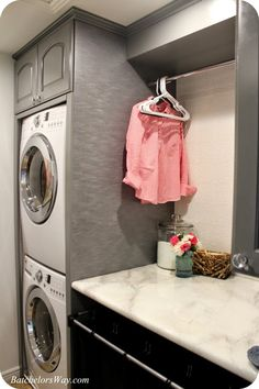 Spot to hang clothes and stacked washer/ dryer