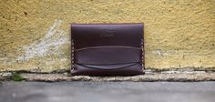 St. Clair   J. Stark    5.5 oz Ox Blood Horween Leather 207 Size Sand Thread 3mm Stitch Length Raw, Beeswax Burnished Edge