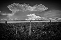 Interesting white clouds behind a corner of barbed wire fence in black and white. Barbed Wire Fencing, Wire Fence, White Clouds, High Gloss, Lens, Corner, Black And White, World, Frame