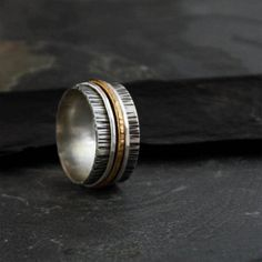 Silver and Gold Textured Spinner Ring by bespokenjewelry on Etsy