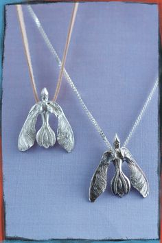 Take Wing pendant in silver and bronze. Combining printing with traditional tecniques and organic casting, to create something unique.