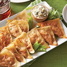 Buffalo Chicken Pot Stickers - Best Party Appetizers and Recipes - Southern Living # fingerfood # partyfood rhs Best Party Appetizers, Snacks Für Party, Easy Appetizer Recipes, Party Recipes, Appetizer Ideas, Chicken Pot Stickers Recipe, Chicken Recipes, Buffalo Chicken, Wan Tan