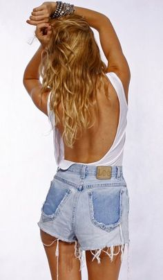 High-waisted shorts and backless shirt; perfect summer attire.