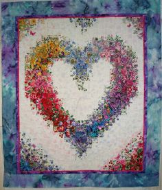 "Made By: Shirley Forster, Gresham, OR   A healing/memorial watercolor heart quilt in memory of my Mom and dog Coco. Most of the 2"" squares were fussy cut so I could get the best angle placement in the heart."