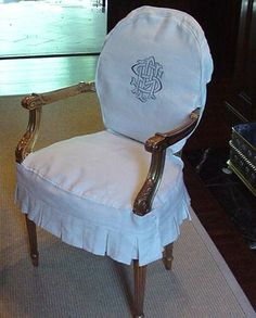 monogrammed chair covers | Monogrammed dining chairs in white linen