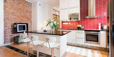 Vhite and black kitchen, brick wall, red backsplash