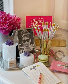 Beautiful decor.Framed Audrey Hepburn pic(Well, Holly). Desk accessories corralled on a silver tray.. Like it A lot!