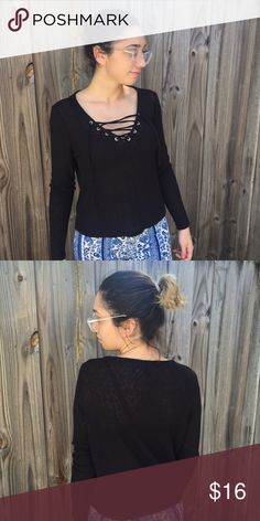 Black Long Sleeve Gorgeous black long sleeve that you can tie in the front or leave the tassels hanging. Never worn out. In perfect condition, bought from H&M. Size Medium. NWOT. Please comment below any questions you may have  H&M Tops Blouses