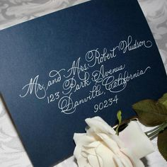 Gorgeous calligraphy, love it against the navy blue envelope. I will be doing this!