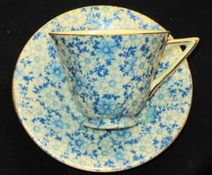 ROYAL DOULTON BLUE CREAM DAISY CHINTZ TEA CUP AND SAUCER