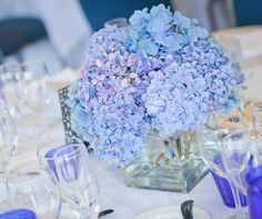 Blue hydrangeas compliment the clear and cobalt glassware.