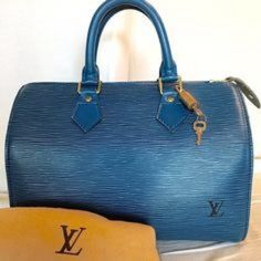 LV blue Rare Limited Edition bag-Speedy 30 LV blue RARE Limited Edition Speedy 30 bag!!!!! SO Stunning!! dust bag included- as well as lock & 2 keys small amount of wear on bottom edges of purse- also small nail polish stain on the handle of purse- other than that it's in beautiful condition- made in 1993- measures 11.8.6 - Limited Edition- sold out Louis Vuitton Bags