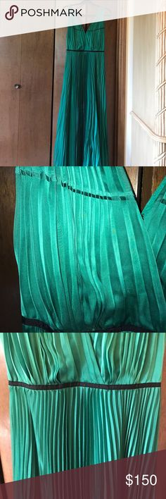 Emerald Green Maxi Formal Dress Brand new with tag!!!! Beautiful pleated silk emerald green dress that's perfect for any formal occasion! Black detailing at waist. ***the zipper is broken but can easily be fixed/replaced*** I bought it like this and was not able to return. Size 4. Measures 62 inches from shoulders to hem. Halston Heritage Dresses Maxi