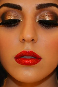Sparkly nude eyes with bright red lip, and to top it off.... a little stick on diamond in the inner corner of the eye!!! Love this!! <3