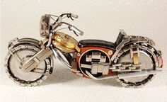 Tiny motorcycle made of wristwatches.