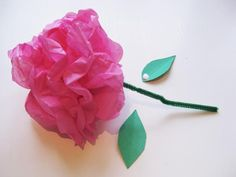 How to Make Tissue Flowers in 10 Easy Steps: Glue your leaves to your flower blossoms.