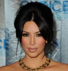 I just can't help it. If I could look like anyone in the world besides my gorgeous self, it would be Kim Kardashian.