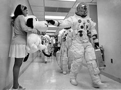 Apollo 10 commander Thomas P. Stafford pats the nose of Snoopy, the mission's mascot, held by Jamye Flowers, astronaut Gordon Coopers' secre...