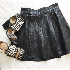 Faux Leather Skirt Faux leather skirt with a faded print. Super cute and has side pockets! Sips close in the back Rock & Republic Skirts Circle & Skater