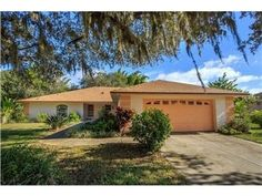 Delightful 4 bedroom 3 bathroom home including attached mother in-law suite. Spacious split floor plan (2813sf). Island kitchen has built in desk and breakfast bar. Living room and dining room have sliding glass doors to lanai. Private guest suite offers living room, dining room, kitchen,  bedroom and bathroom.  Screen enclosed lanai plus open patio. Landscaped with mature Oak trees. Located on a .55 acre fenced lot in the pleasant SE community of Cypress Grove.