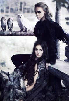 The Dark Sisters.  I am, of course the blonde with the superior eye makeup.  You're the brunette with the owl fetish.