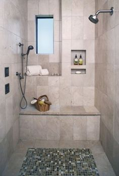I love this shower!! Love the mosaic tiles and the bench/shelves