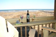 Sand Flee. SC02. 2 bedroom oceanfront condo in Kill Devil Hills. 2 full baths. Beds:Queen, 2 Twin. Beds made, bath towels provided. Outdoor pool. Phone: 855.585.8811