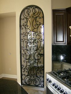Custom Wrought Iron Services Including Exterior And Interior Railings Decorative Inserts Wine Room Doors